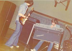 Danny Imig, age 14, with his very first guitar, a Univox High Flyer, in the band EFFIGY, playing a Beecher High School dance, 1974. Rocking the Farfisa keyboard bandmate John Knuth. Photo by Al Stanbro.