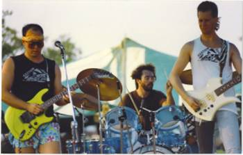 "CERTAIN DEATH, 1987, at Chicago's annual ""Peacefest"", Montrose Harbor Park. (L to R) Danny Imig, guitar. Mike Imig, drums. Jeff Anderson, bass. Photo by Ron Zygmunt."